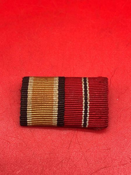 German pair of 2 ribbon bar awards iron cross, eastern front medal nice used condition uniform removed from German prisoners of war captured it came from the local museum in Monte Cassino the Italian battlefield of 1944 which closed down in 2015