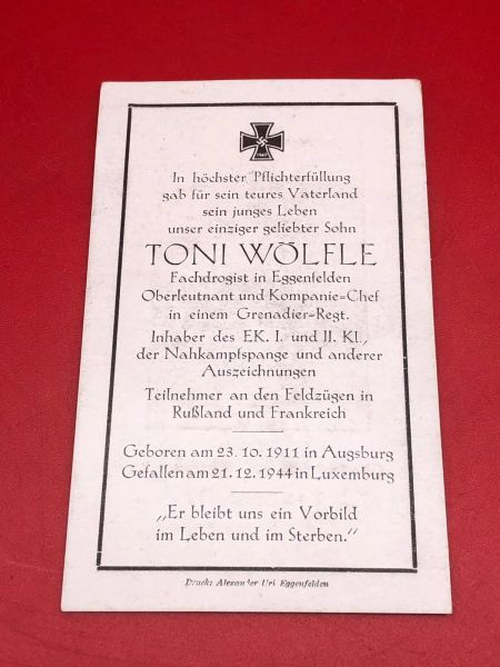 Very rare Original German soldiers memorial death card nice complete condition for Lieutenant Toni Wolfle in a grenadier regiment he won iron cross 1st and 2nd class he died 21st of December 1944 in the Ardennes forest during the battle of Bulge