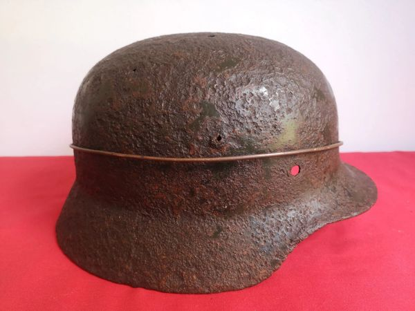 German soldiers M40 steel helmet with some green paint remains recovered from the battlefield around Houffalize in the Ardennes where the 116th panzer division fought in the 1944-1945 battle of the Bulge