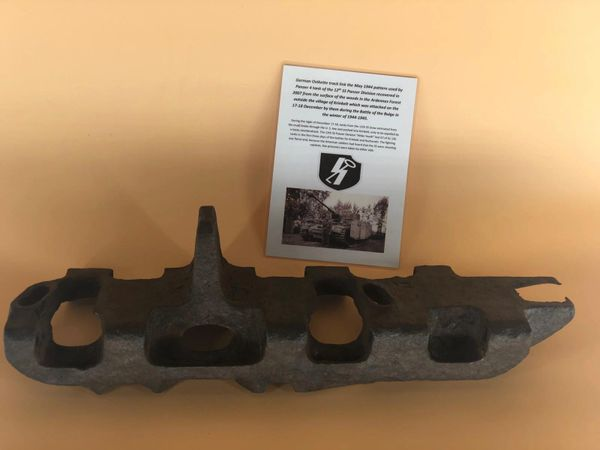 German complete Ostkette track link 1944 pattern, relic condition with rust damage used by Panzer 4 Tank of the 12th SS Panzer Division recovered in 2007 in the Ardennes Forest, village of Krinkelt, attacked by them during the Battle of the Bulge
