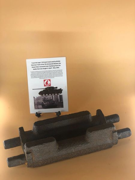 Steel track link T-49 steel tread type, nice condition with maker number used by British Sherman Tank of the 7th Armoured division the desert rats recovered near Hamburg from the battle that was fought in April-May 1945.