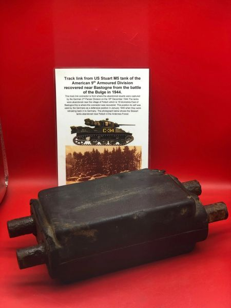 Track link rubber block pattern with maker markings from US Stuart M5 tank of the 9th Armoured Division recovered from near Bastogne from the battle of the Bulge in 1944 with photograph of the tanks in 1944