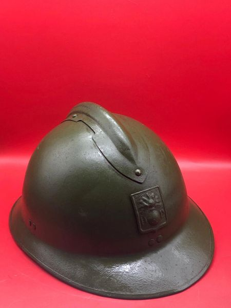 Very nice condition not relic French soldiers M1926 Adrian helmet complete with Défense Passive badge over painted with green paintwork some original paintwork inside and maker marked found on a brocante in Albert, Somme battlefield of world war 1