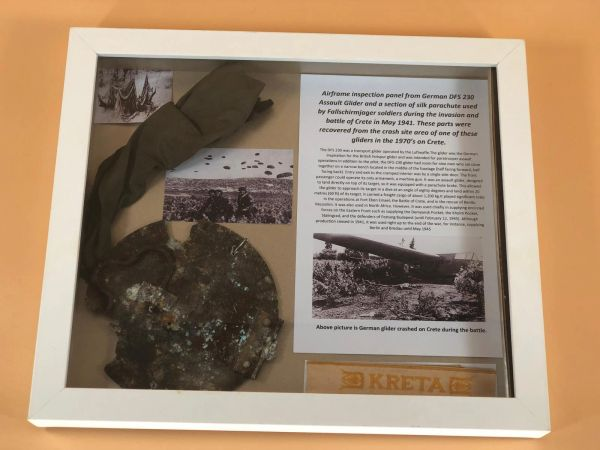 Glass framed relics from the recovery of a German DFS 230 Assault Glider crashed during the Battle of Crete in May 1941