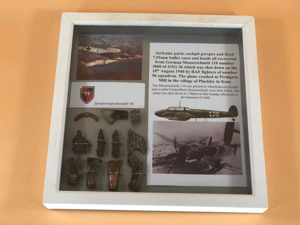 Glass framed relics from ME110 No. 3060 shot down on 18 August 1940 at Pivington Mill in Pluckley, Kent