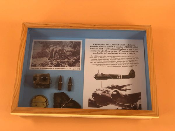 Glass framed engine parts and bullet heads from a JU88A-4 bomber shot down over South East England on 13 August 1940 in Swanbourne Lake