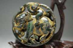 Carved Stone Pendant of a Monkey Riding an Elephant