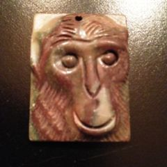Carved Stone Pendant of a Monkey Face