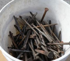 """5 Gallon Bucket of 12"""" and Mostly 10"""" Nails"""