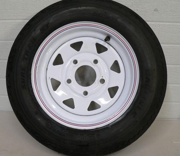 Carlisle Super Trail ST Tire with White Spoke 5 Hole Wheel