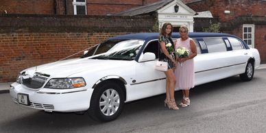 mum + daughter standing in front of limousine