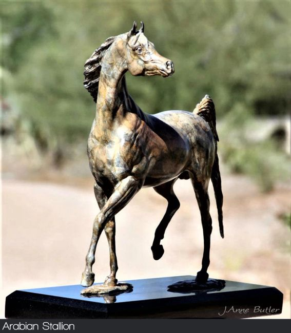 Bronze stallion sculpture in contemporary bronze patina.