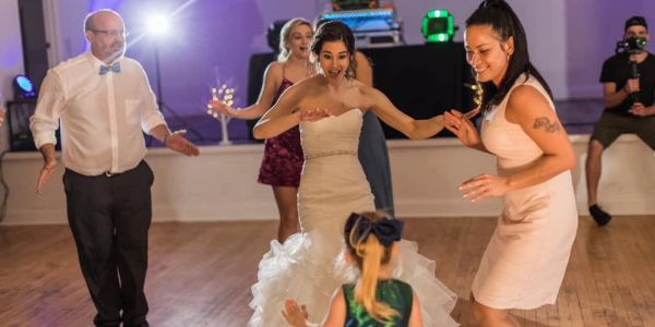 Bride dancing with guest