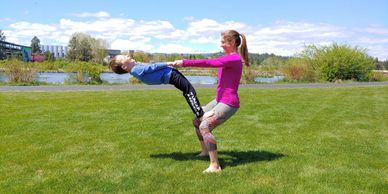 Outdoor Family Yoga Class at Free Spirit Yoga + Fitness + Play in the Old Mill District, Bend, OR