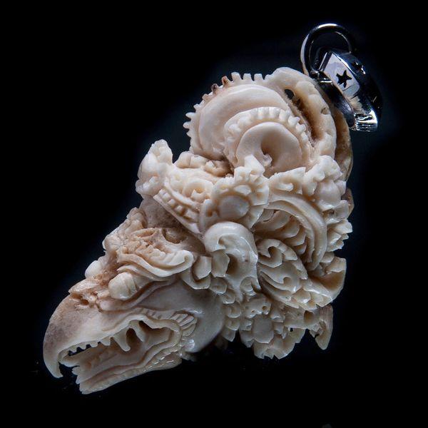 74. Garuda Head - Sterling Silver & Bone Pendant