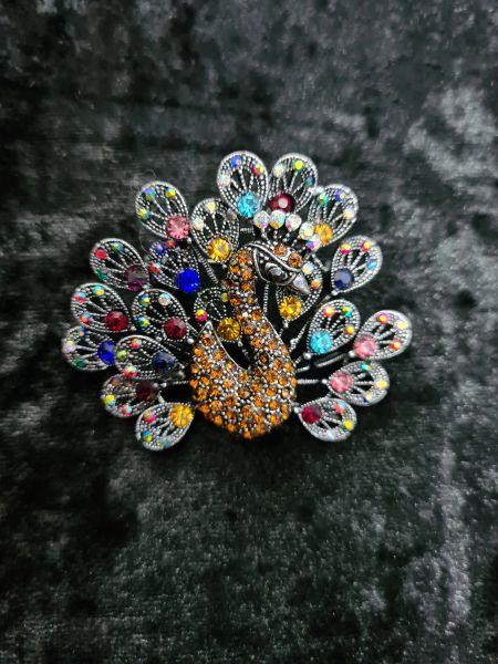 Art deco inspired peacock brooch