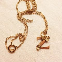 Rose gold initial with tiny gold flowers