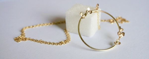 Delicate gold flower hoop