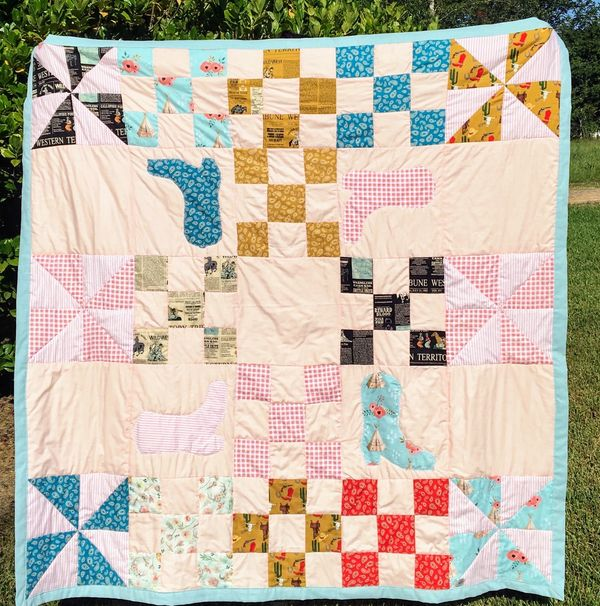 "Our 58"" x 58"" western themed quilt is made with high quality cottons laid out in pinwheels, nine pat"