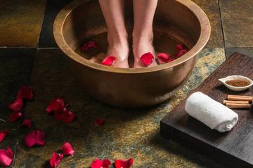 Copper basin-foot soak, sprinkled rose petals, herbal foot bath, tranquil spa, Maine, spa services