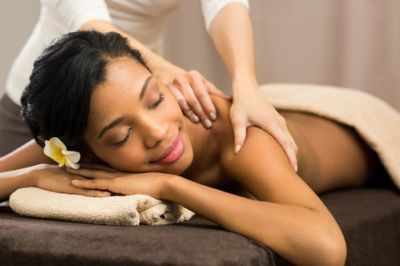 Brown lady getting a massage therapy treatment at a Maine massage therapy spa