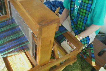 This weaver creates a tartan at a Celtic festival