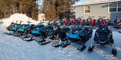 A row of snowmobiles for sale in West Yellowstone at Highmark Rentals