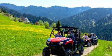 A group enjoying their West Yellowstone ATV rentals while climbing an alpine trail