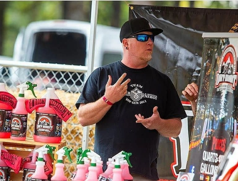 Dirt Bandit owner Josh, with Dirt Bandit products, explaining its noncorrosive, cleaning properties.