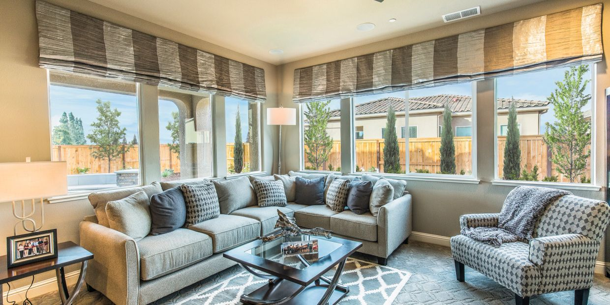 Beautiful family room with a lot of Anlin windows installed.