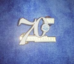 Amicae 70th anniversary lapel pin