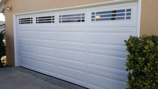 Steel garage door long panel white by garage doors 4 less.
