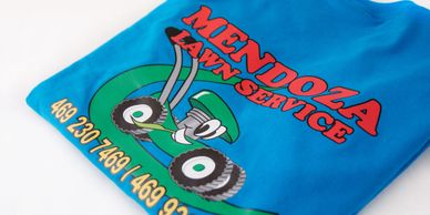 Blue t-shirt with a lawn mowing logo