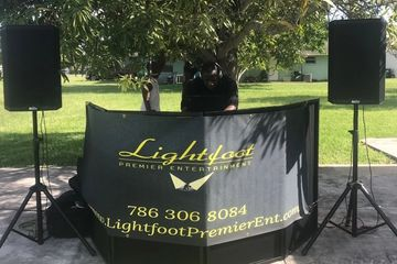 DJ Lightfoot Premier Entertainment djing kids backyard party outside under tree with PA system