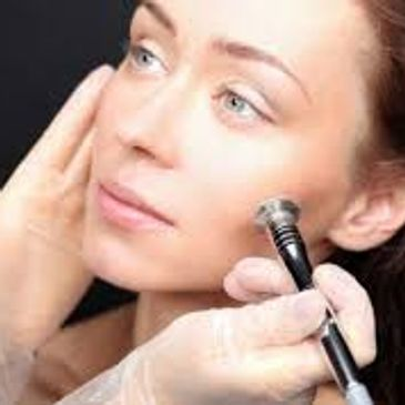 Microdermabrasion will help exfoliate and brighten the skin. Removing dead skin cells.