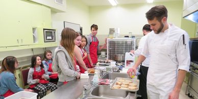 Accelerate Youth students in the kitchen learning how to create affordable, healthy meals.
