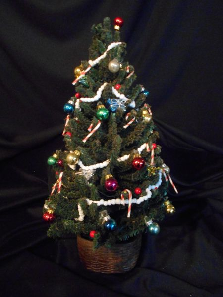 Lighted Christmas Tree.Decorated Lighted Christmas Tree In Resin Pot
