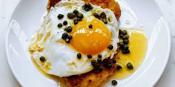 Pan-fried turkey escalope, fried duck egg and caper beurre noisette
