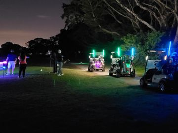night golf glow golf event with promotional products offered in delray beach golf course with golf