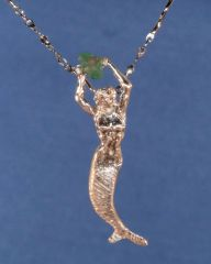 Mermaid in Sterling Silver holding .50K raw Emerald