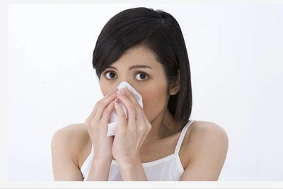 Woman with nasal allergy symptoms