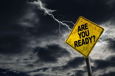"Sign with ""Are You Ready"" being struck by lightening emphasizing the need for business resiliency."