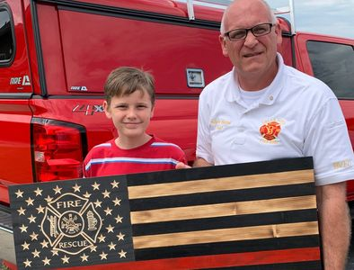 We donated a Red Thin Line rustic wooden flag with carved stars & emblem to Bella Vista Fire Dept.