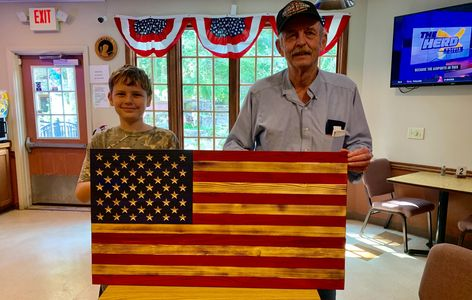 Beautiful rustic wooden 50 Star American Flag with carved stars and emblem at the American Legion