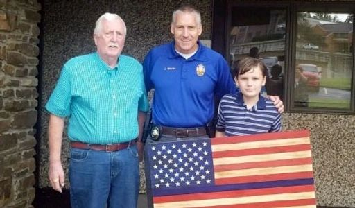 We donated a rustic wooden Police Blue Thin Line flag with carved stars to Bella Vista Police Dept.