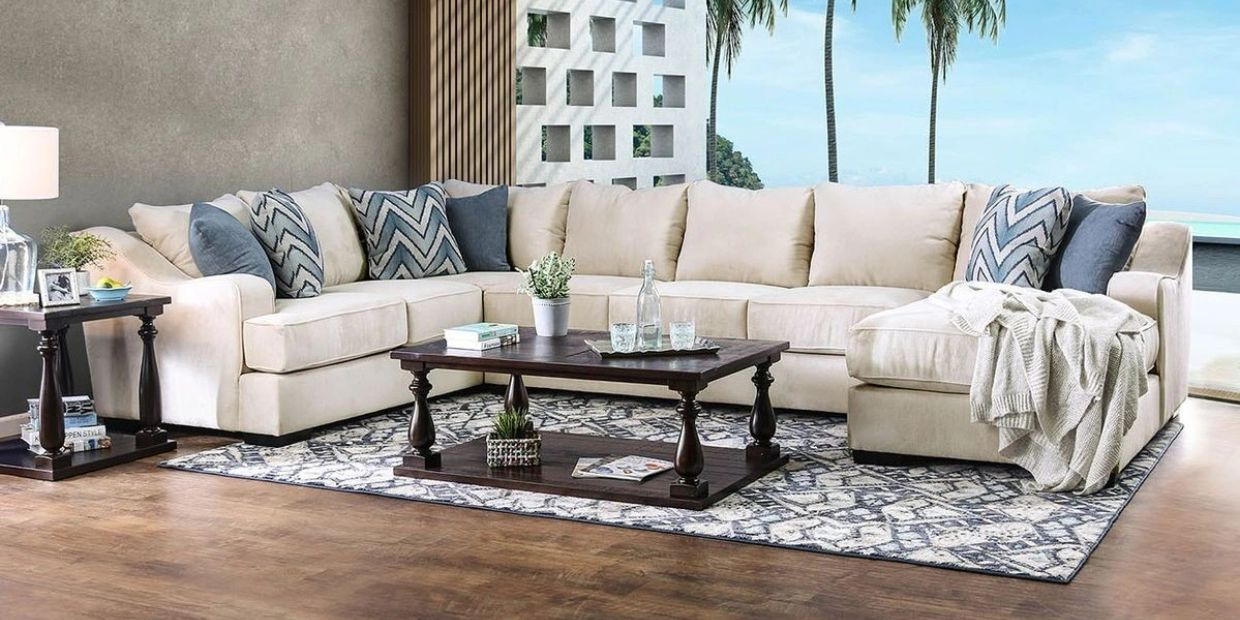 America Made sectional in ivory with blue pillows
