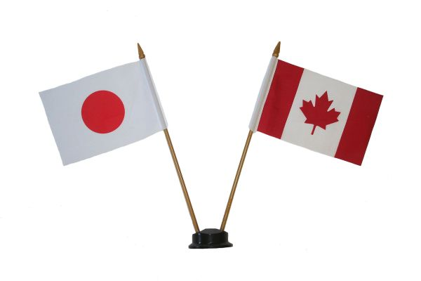 "JAPAN & CANADA SMALL 4"" X 6"" INCHES MINI DOUBLE COUNTRY STICK FLAG BANNER ON A 10 INCHES PLASTIC POLE .. NEW AND IN A PACKAGE"