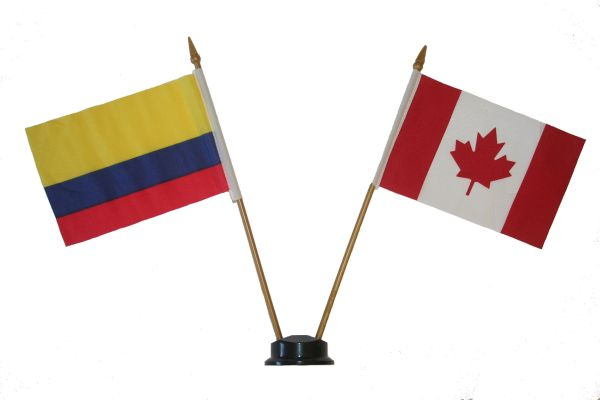 "COLOMBIA & CANADA SMALL 4"" X 6"" INCHES MINI DOUBLE COUNTRY STICK FLAG BANNER ON A 10 INCHES PLASTIC POLE .. NEW AND IN A PACKAGE"
