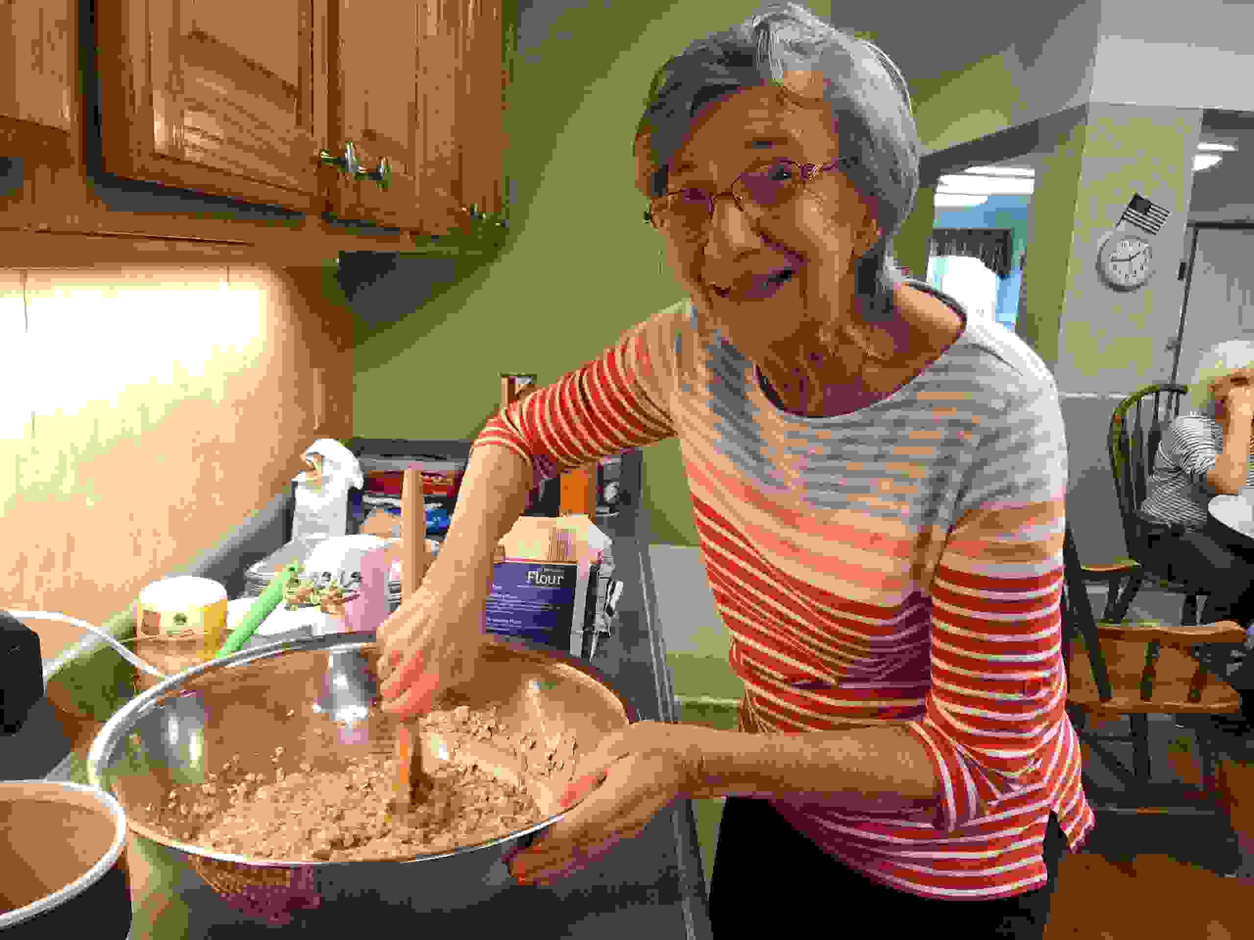 Resident mixing cookie dough during baking activity!