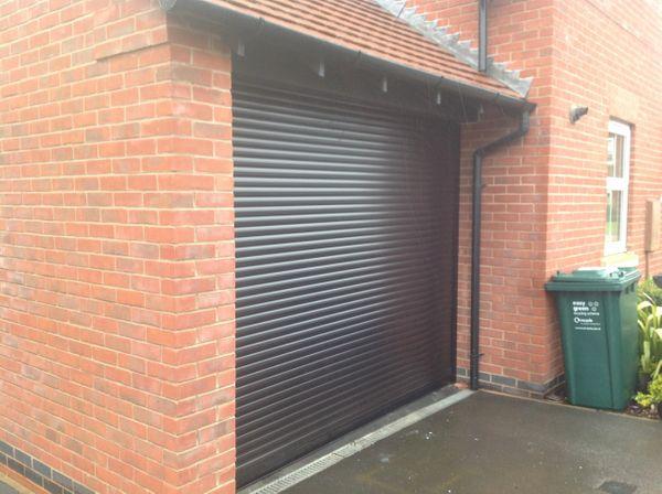 EG55 Black Roller Electric Garage Door 8X8